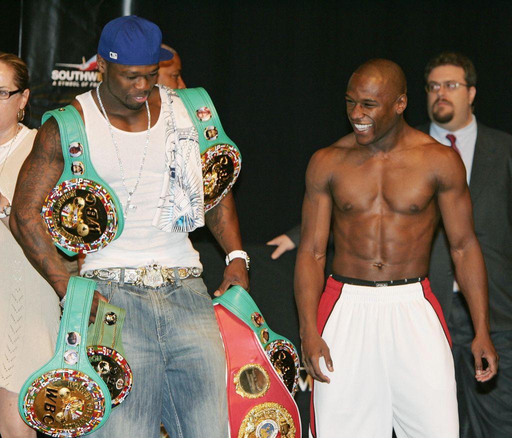 Rapper 50 Cent (L) holds Floyd Mayweathe...
