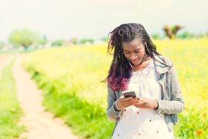 Young African woman checking for messages