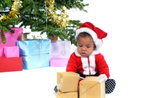 Baby Santa Looking at his Presents