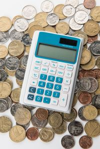 A calculator is on a pile of coins