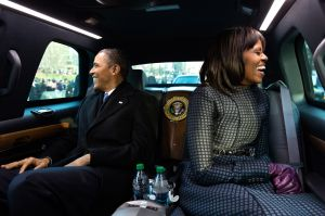 President Barack Obama and First Lady Michelle Obama riding in the Presidential limo.